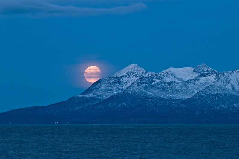 moon over a snow covered Senja, Northern Norway