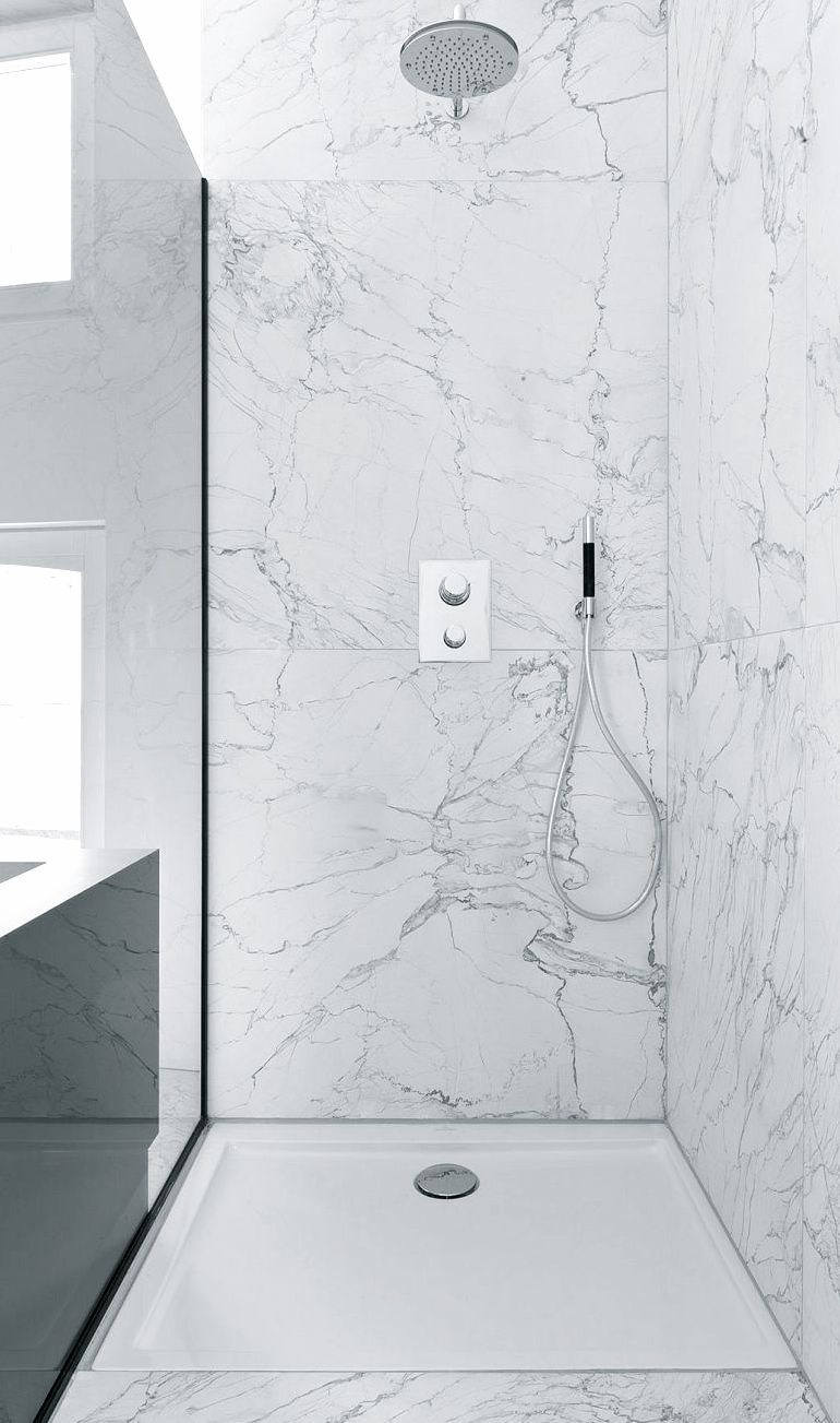 Like the idea of the very large marble tiles - less grouting, plus ...