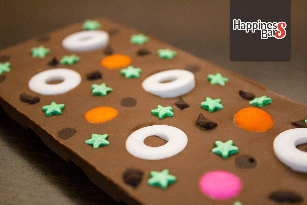 Milk chocolate happiness bar with peppermints, green stars, chocolate candy and chocolate drops :)