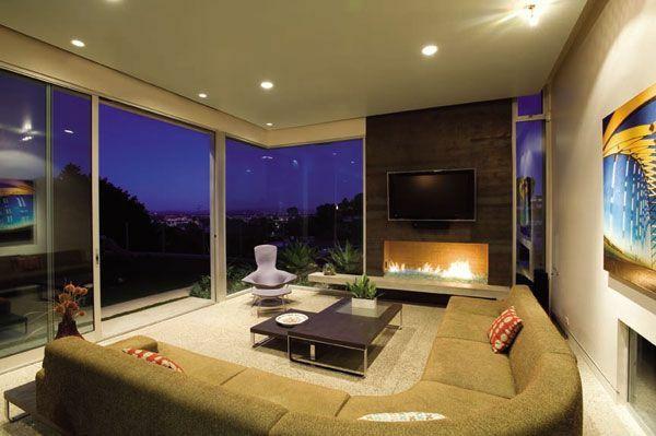wohnzimmer ideen mit prchtiger aussicht rundes sofa tv kamin - Wohnzimmer Ideen Mit Kamin
