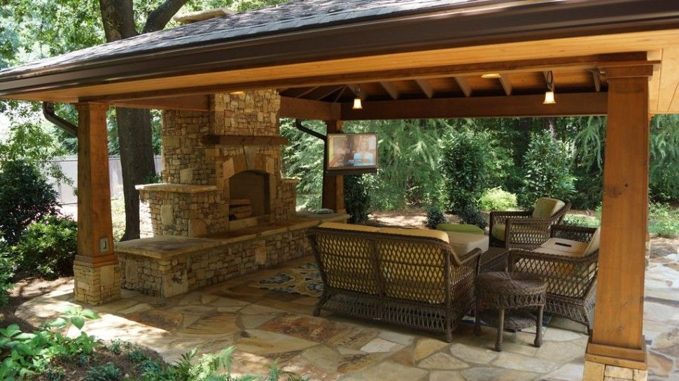 Exterior Divine Covered Outdoor Sitting Area With Brick Stone Fireplace Also Wicker Sofa Furniture Plus Corner Tv On Wooden Pillars Sophisticated