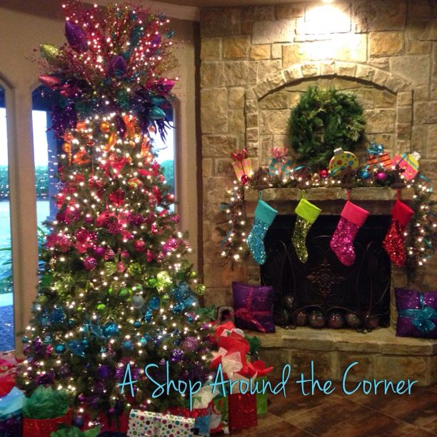 LOVE the colors in this tree!  Decorated by:  A Shop Around the Corner! New Braunfels, TX