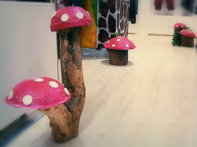 We took second hand salad bowls, paired it with some tree stumps and instantly we had some magical toadstools.