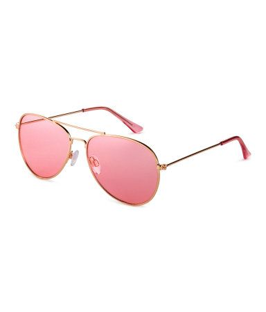 6ae6e8a95e Pink. Aviator-style sunglasses with metal frames and tinted lenses. UV- protective.