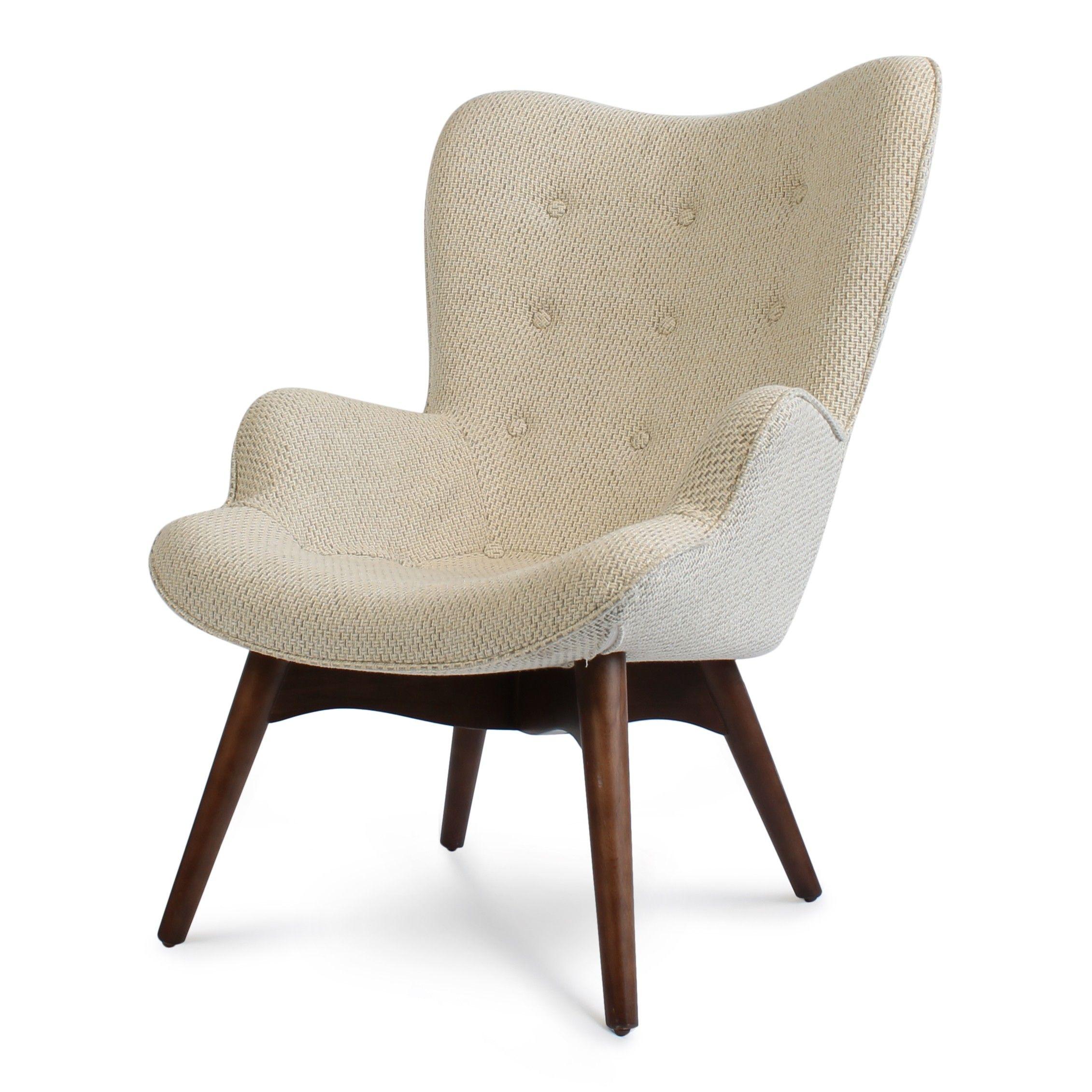 de wagon fauteuil heeft ronde vormen gecombineerd met een strak onderstel gemaakt van walnoten. Black Bedroom Furniture Sets. Home Design Ideas