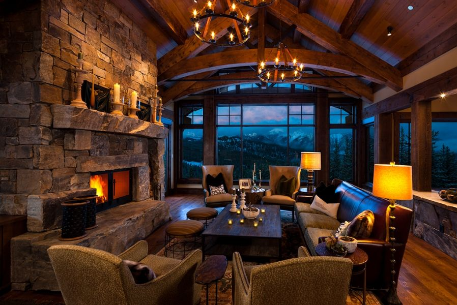 Great Room With Awesome Windows Massive Stone Fireplace Wood Beams Wood Floor Beehive In Big Sky Mt By Reid S Timber House Rustic House Log Cabin Kitchens