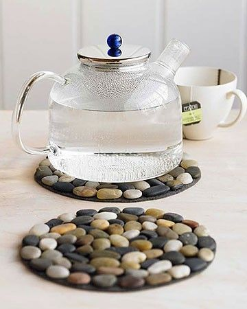 """(-from a tumblr pic, so no link... but the trivets would be easy - it says felt, but you could even use """"$1 store"""" cheap coil trivets. Hot glue the stones to them and you have yourself an eyecatching addition to your countertops!! Oh, and I am loving the kettle, too. May have to search for one similar )"""