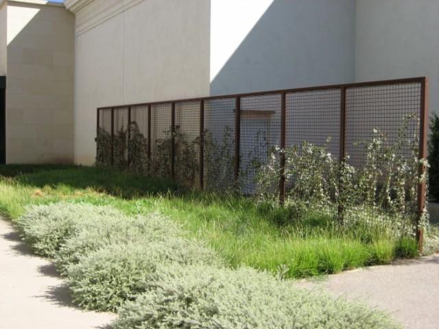 Western fence company rusted metal look steel grid
