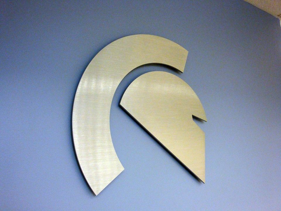 Custom cut-out brushed stainless steel metal logo NYC - We specialize in custom metal signage in New York, NY. Visit our website below to contact us for a free consultation! www.SignsVisual.com