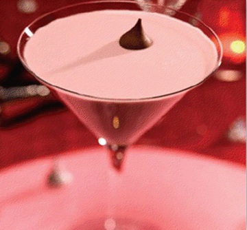 Chambord French Kiss    Ingredients:  •1 oz. Chambord   •1.oz Vodka  •1oz. Dark Crème De Cacao   •1 ½ oz. Half & Half    Preparations  1.Fill mixing glass with ice   2.Add all the ingredients   3.Shake and strain into a chilled martini glass   4.Add a Hersey kiss