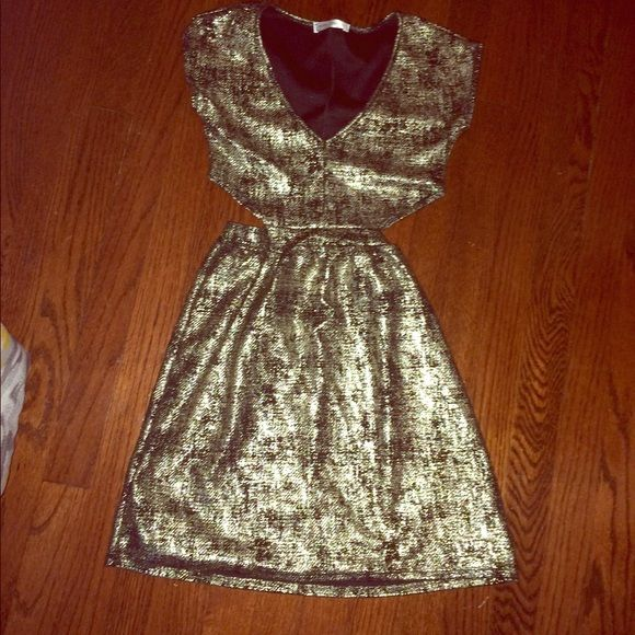 Gold and black dress Gold and black dress from body central never worn!good condition.it is a small but may fit medium.i am a small but it didn't really fit,it was a little too big on me. Body Central Dresses Midi