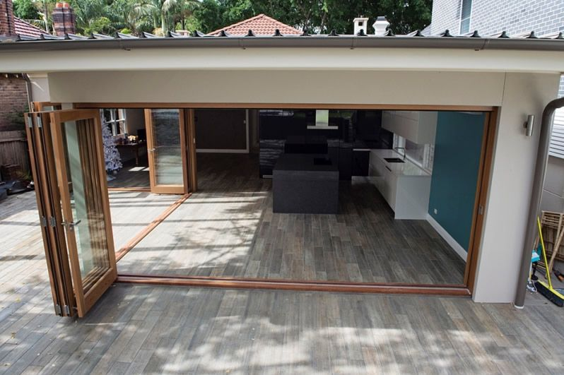 timber wood look floor tiles for outdoor use with bifold doors