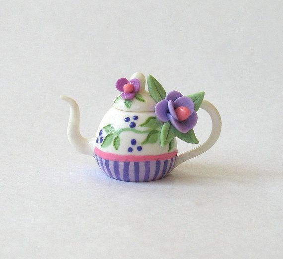 This miniature lovely purple blossoms and stripes teapot is a one of a kind original design and creation by artist C. Rohal. It is completely hand