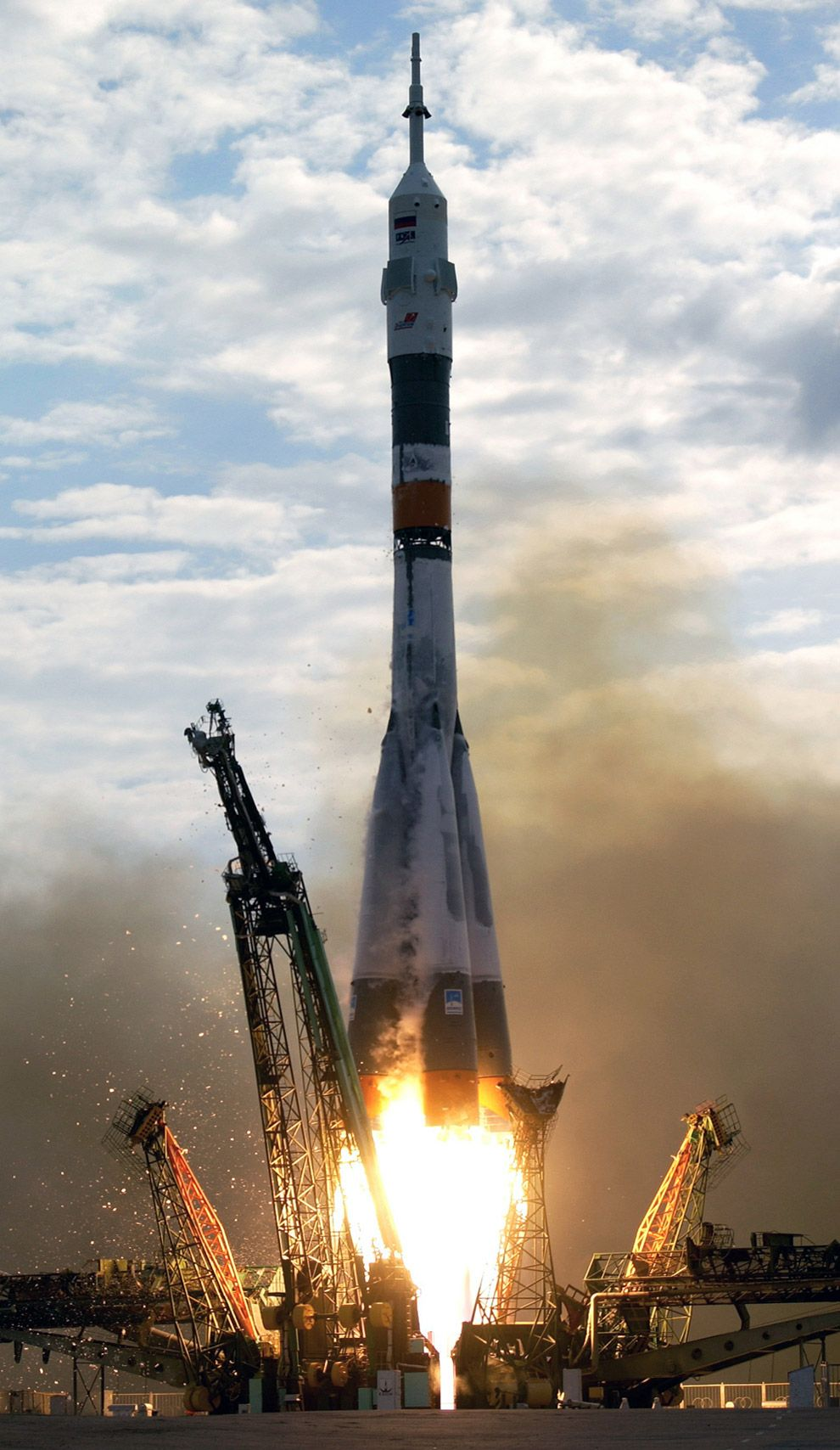 A Soyuz spacecraft lifts off from the Baikonur Cosmodrome, Kazakhstan, at 10:54 p.m. (CDT) on April 26, 2003