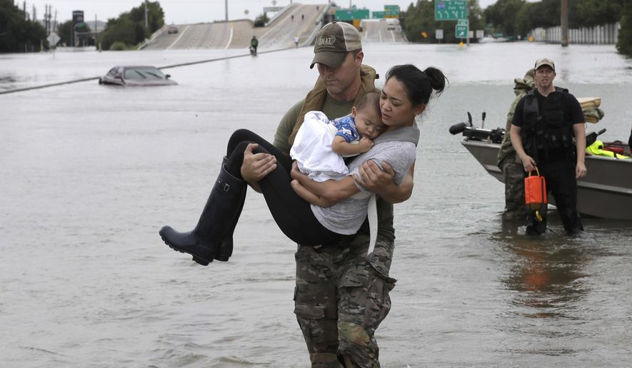 Image result for Houston Police SWAT Officer Daryl Hudeck carries Catherine Pham and her 13-month-old son, Aiden, after rescuing them from their home surrounded by floodwaters from Hurricane Harvey on Aug. 27, 2017 in Houston.