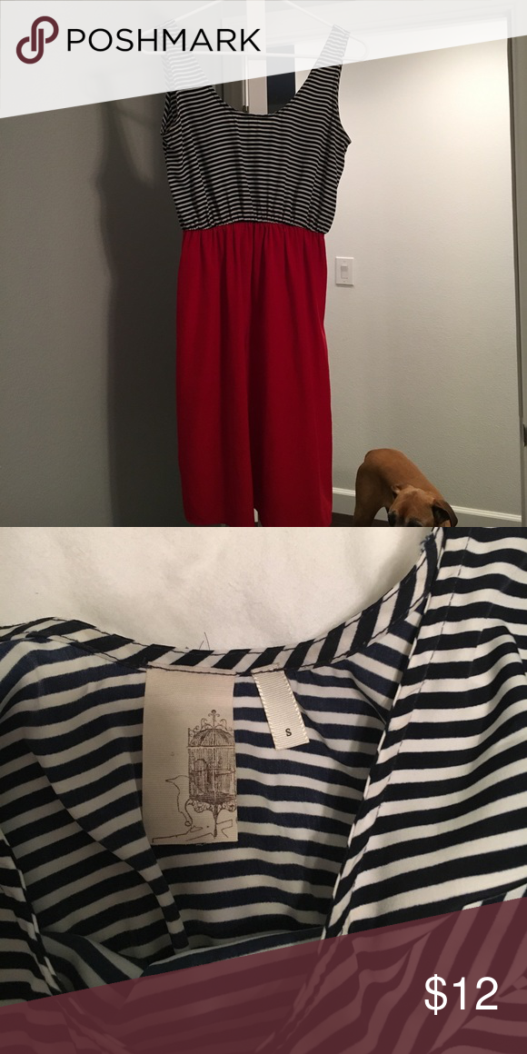 Striped dress Sleeveless dress.  Navy and white stripes on the top and vibrant red bottom.  Size small.  Bought it with high hopes of wearing it and I just haven't pulled it off.  Needs a loving home!!! Dresses