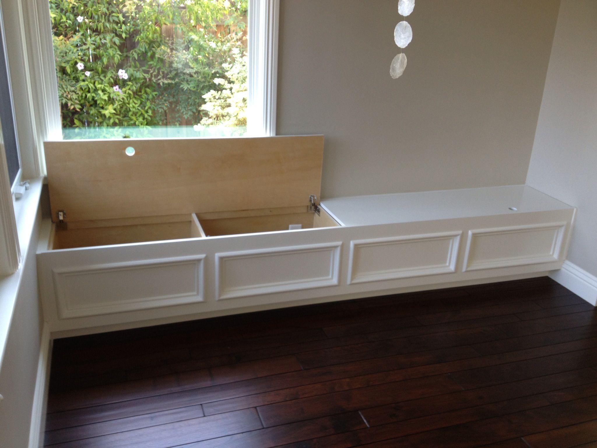 Built in bench seat with storage put along wall in family room for extra seating