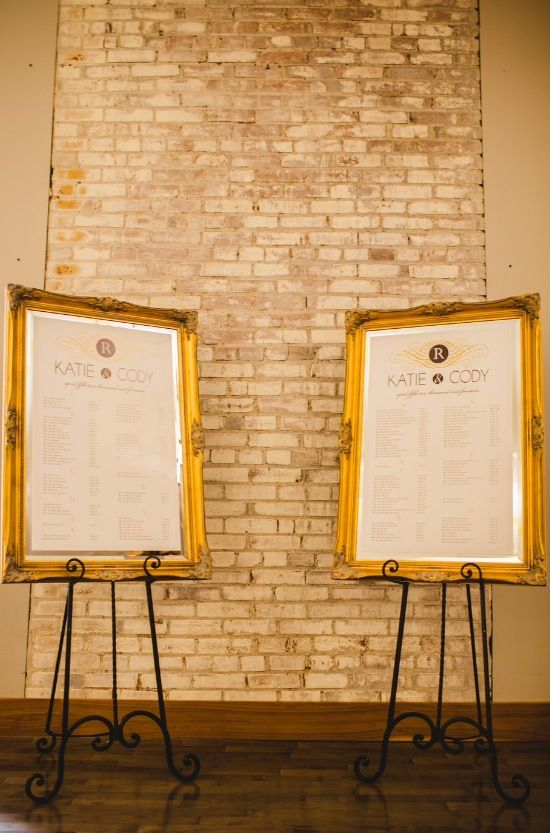 Gold  ivory wedding seating charts on big frames and black easels also rh pinterest
