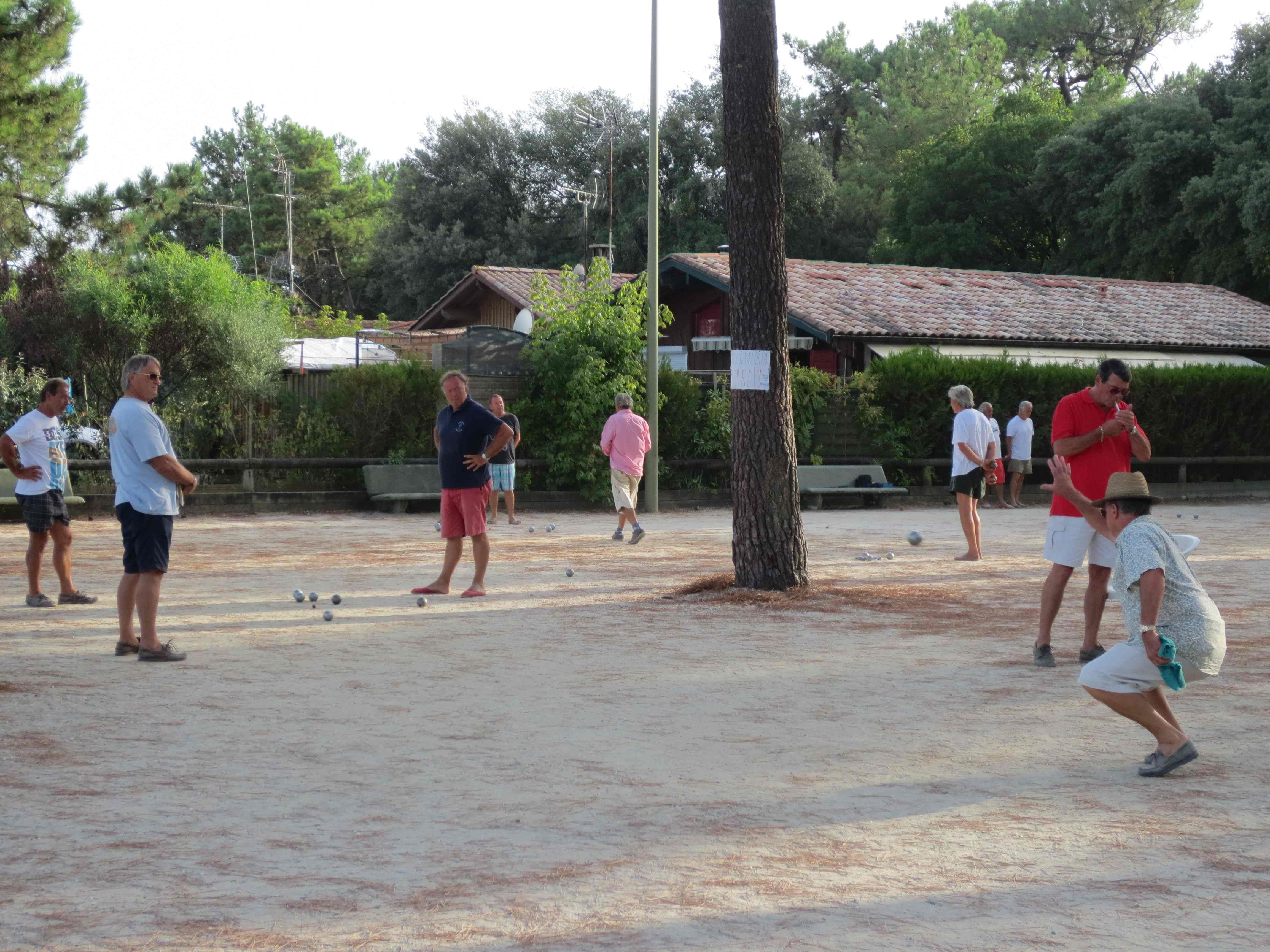 People playing pétanque - traditional french summer sport - Cap-Ferret 2012 | Photo credit: Jana Kravitz