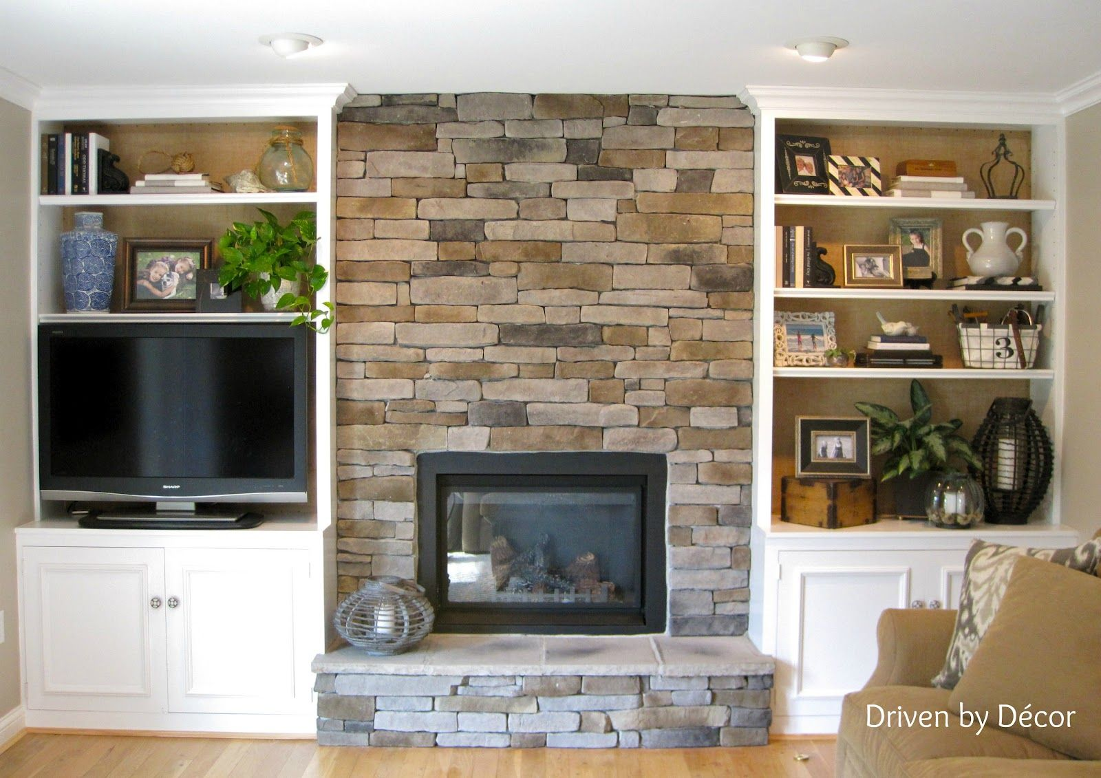 Living Room With Fireplace And Helves transforming a fireplace and built-in bookcases - love the stone