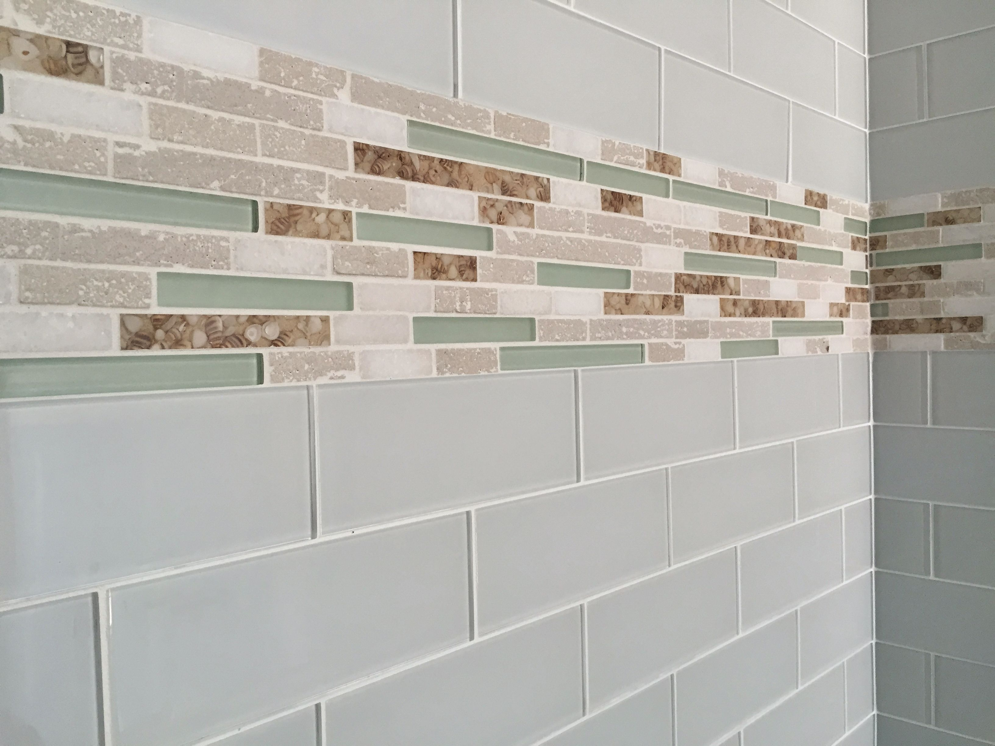 3x6 Gray Gl Tile With Stone And Shell Accent Strip In Guest Shower