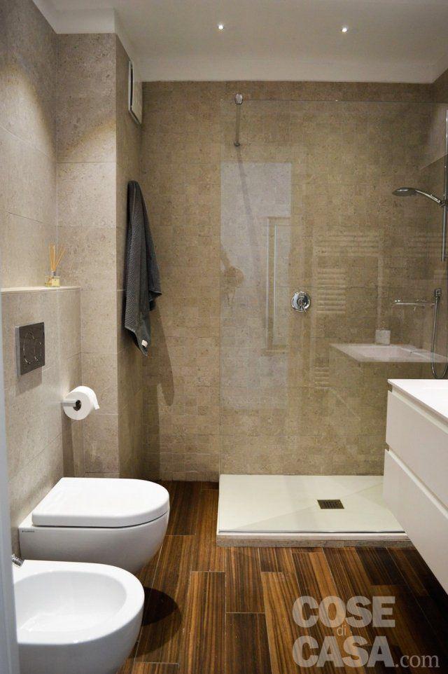 Una mansarda con scala elicoidale e pavimento in piastrelle effetto legno products i love - Pavimento bagno effetto legno ...