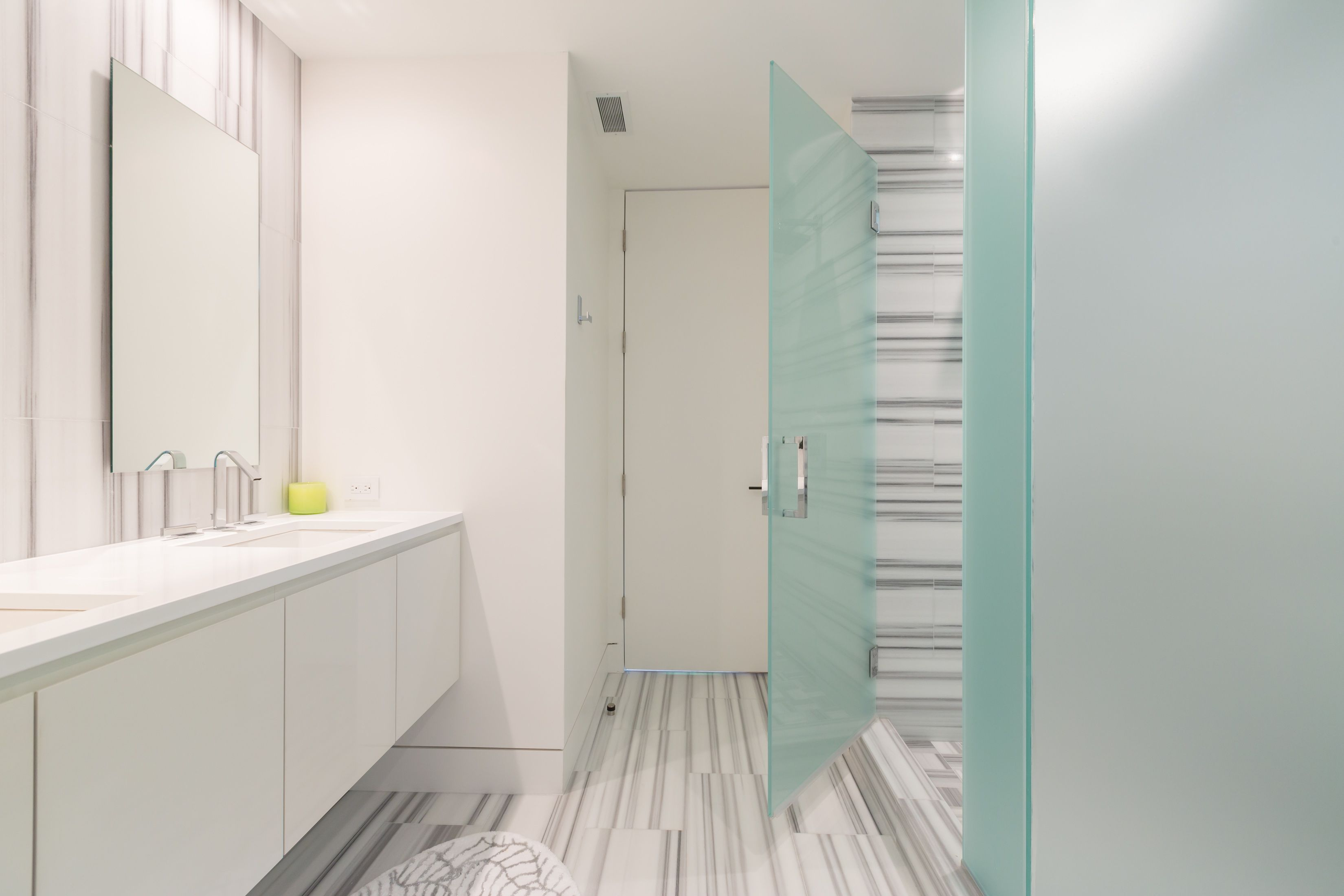 Modern guest bathroom with StoneSource Linac marble