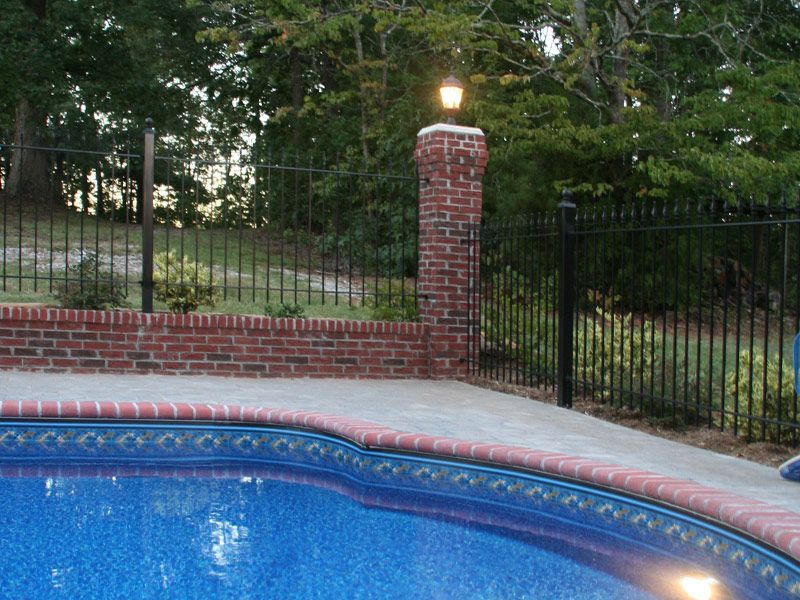 A Corner View Of Our Astonishing Fence With Brick Pillars And A Glistening Light Post Diy Pool Fence Pool Fence Diy Pool