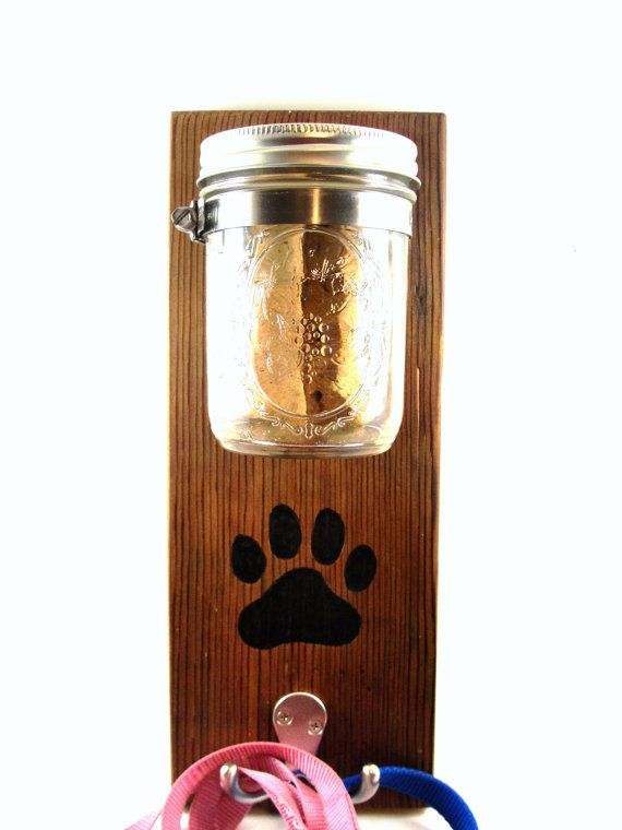 Keep your dog treats and leashes ready to go in a unique and funktional style  Upcycled cedar board is naturally dark, I have rubbed it with