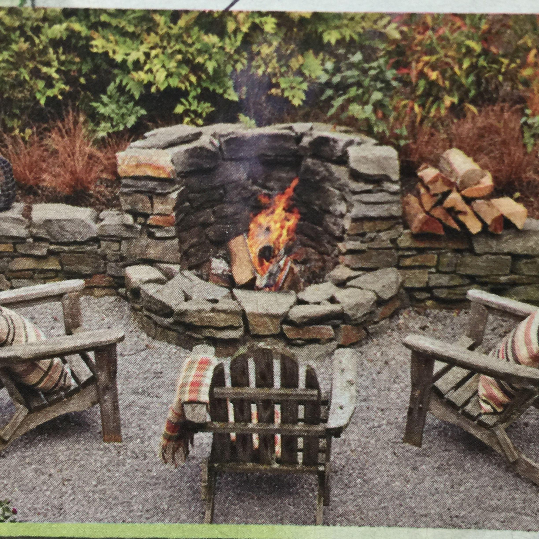 Fire Pit built into Rock Wall #firepitideas