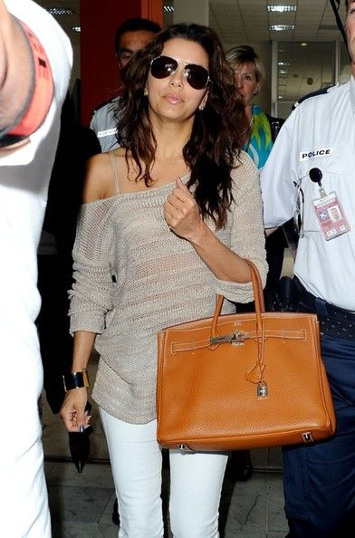eva longoria is so cute and tiny! i sooo want her open-knit gray sweater...one of my favorite clothing items to wear!