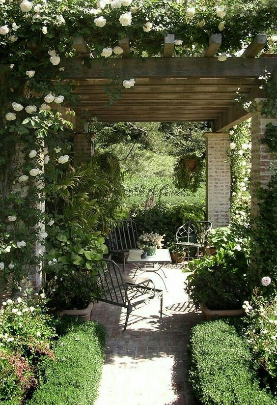 Inspiration for outdoor seating area using gravel, garden pavers, a pergola, greenery, and outdoor furniture. Great for entertaining or relaxing!