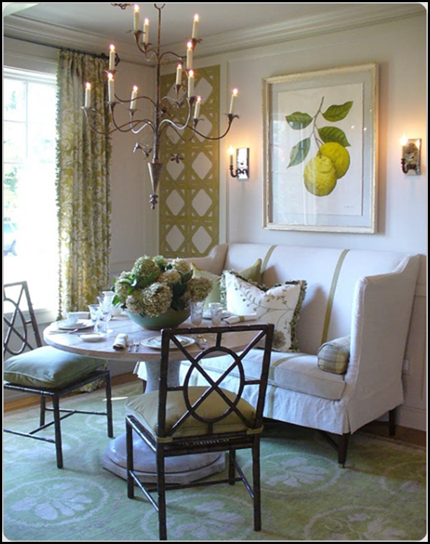 High Back Settee In Dining Room With A Round Pedestal Table
