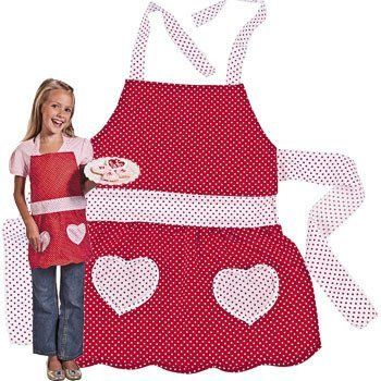 """Girls Red Polka Dot Apron by FE. $6.00. Child's Valentine Apron. Your child will love to help make some Valentine treats! Cotton. 18 3/4"""" x 15"""" with 18"""" waist ties and 12"""" neck ties. Imported."""