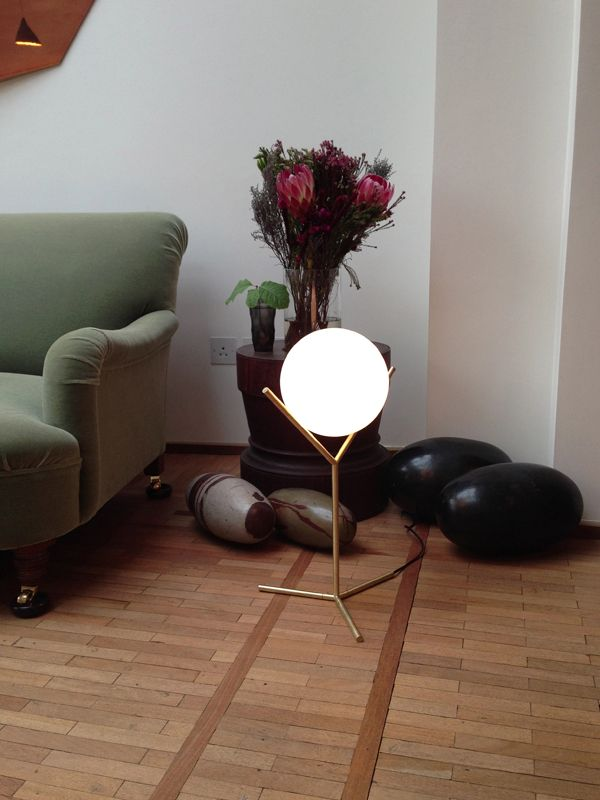Michael Anastassiades' table IC Light in brushed brass.