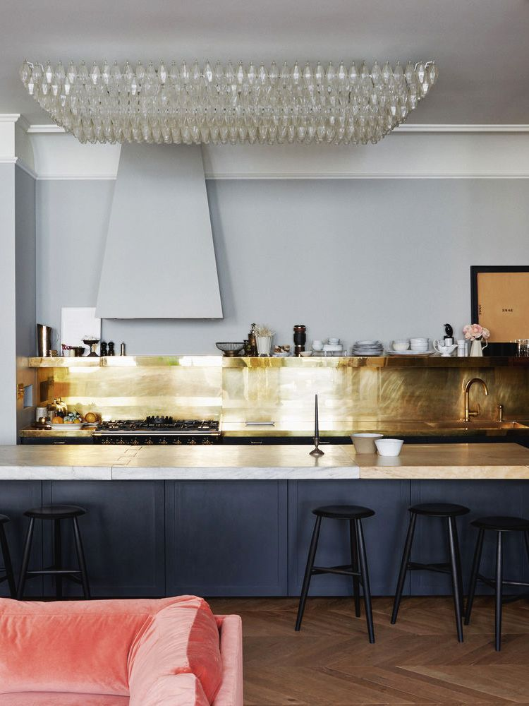 Dramatic Chandelier In The Brass And Black Kitchen | Jenna Lyons House Tour  On Coco Kelley