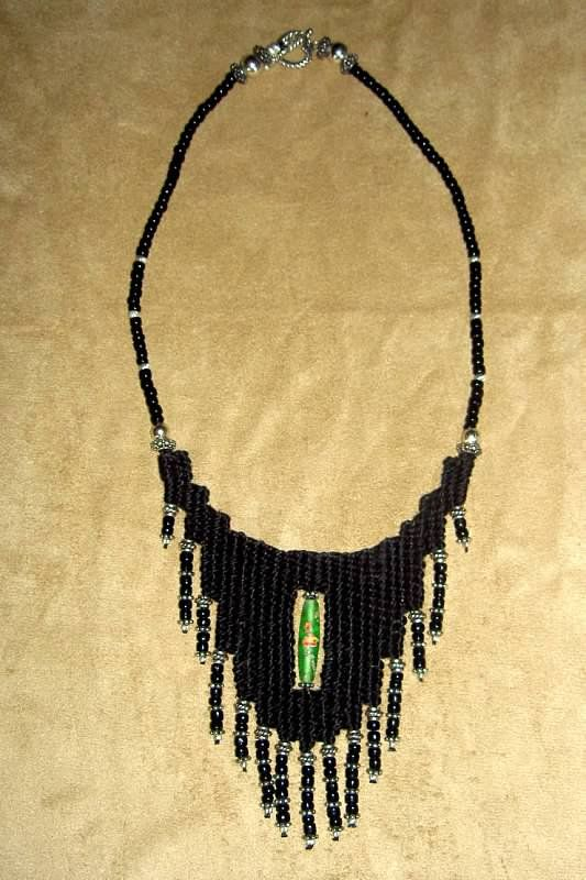 """The """"Kat"""" - 2010 - Fixed Length, Sterling Silver beads and clasp, Green hand painted glass bead centerpiece, SOLD.  Hand woven, handwoven, weaving, weave, needleweaving, pin weaving, woven necklace, fashion necklace, wearable art, fashion necklace, fiber art."""