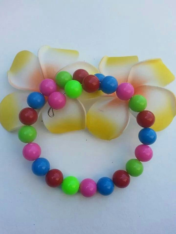 Handmade children\'s bracelet made from plastic beads which can ...