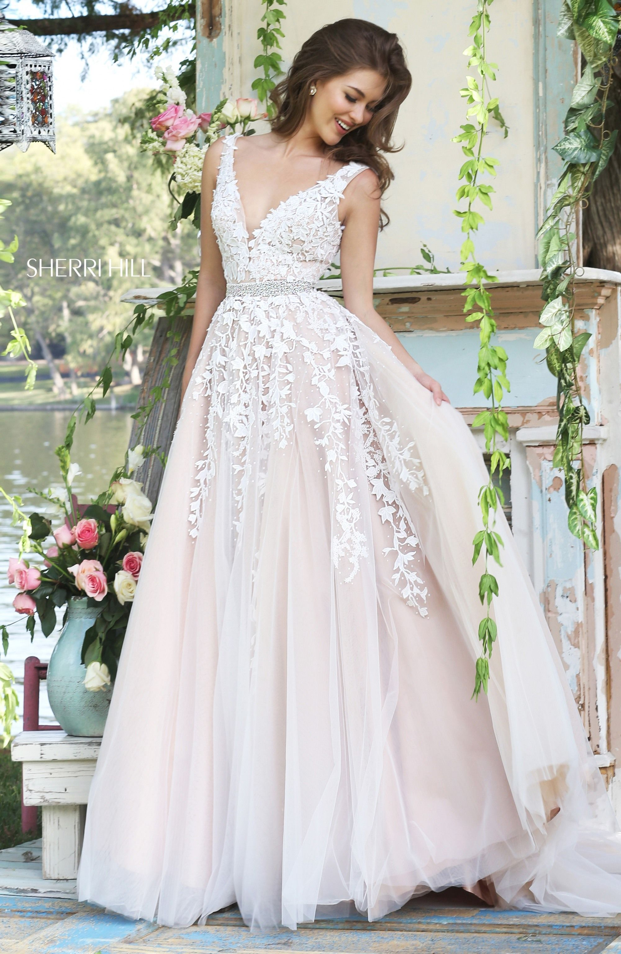 This sherri hill prom dress features a beautiful aline