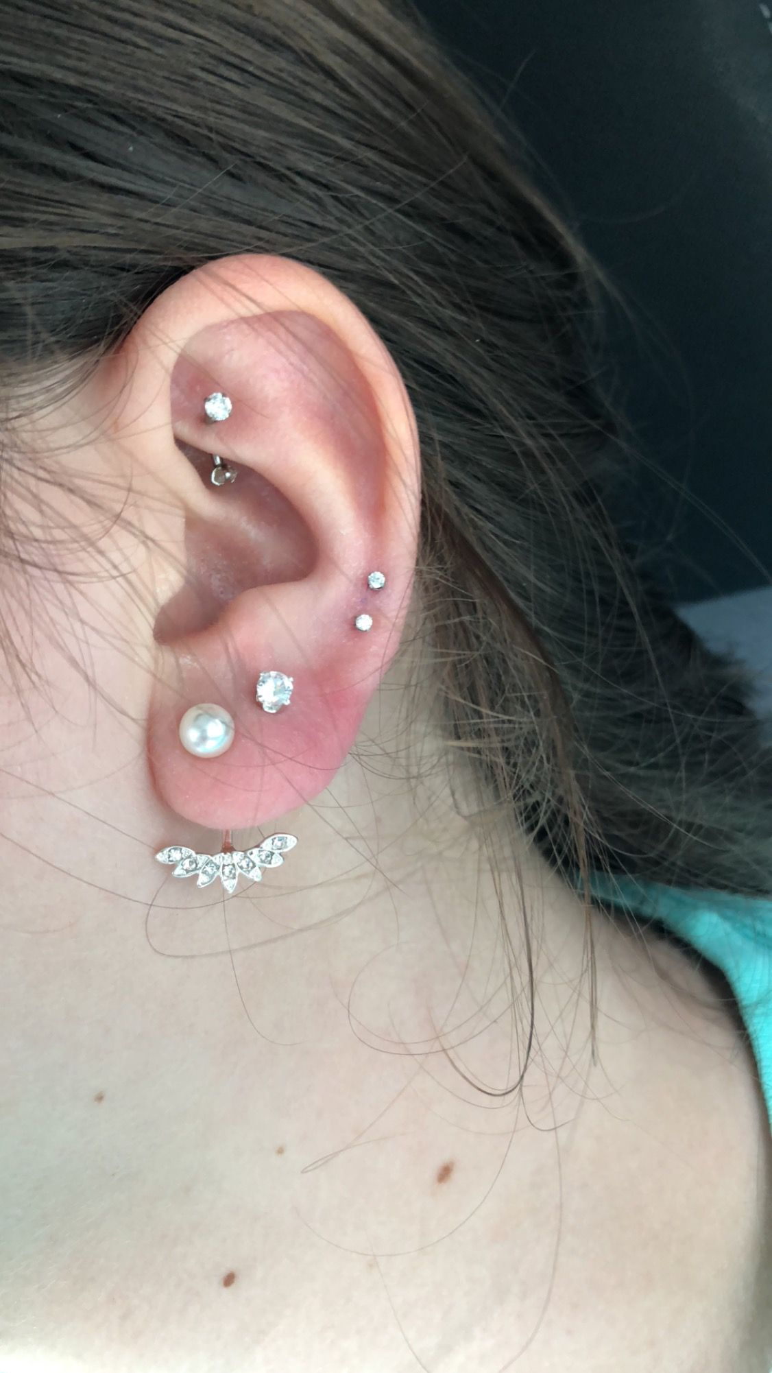 hight resolution of rook piercing upper lobe lower cartilage and double lobe