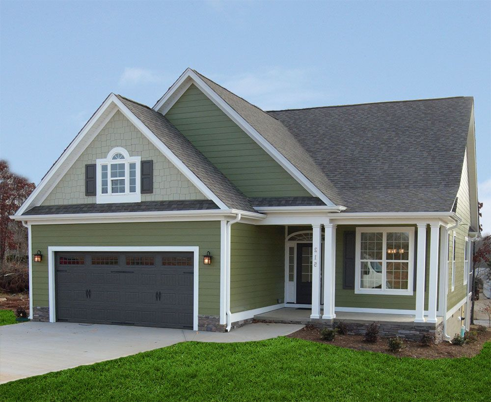 The smythe plan 973 this narrow lot house plan has a front entry garage - Narrow house plan paint ...