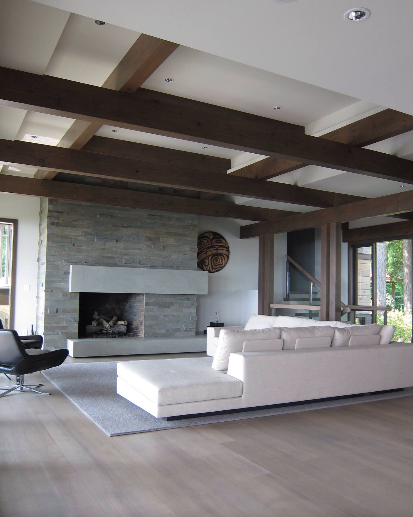 Floating fireplace with slate ledger stone in living room