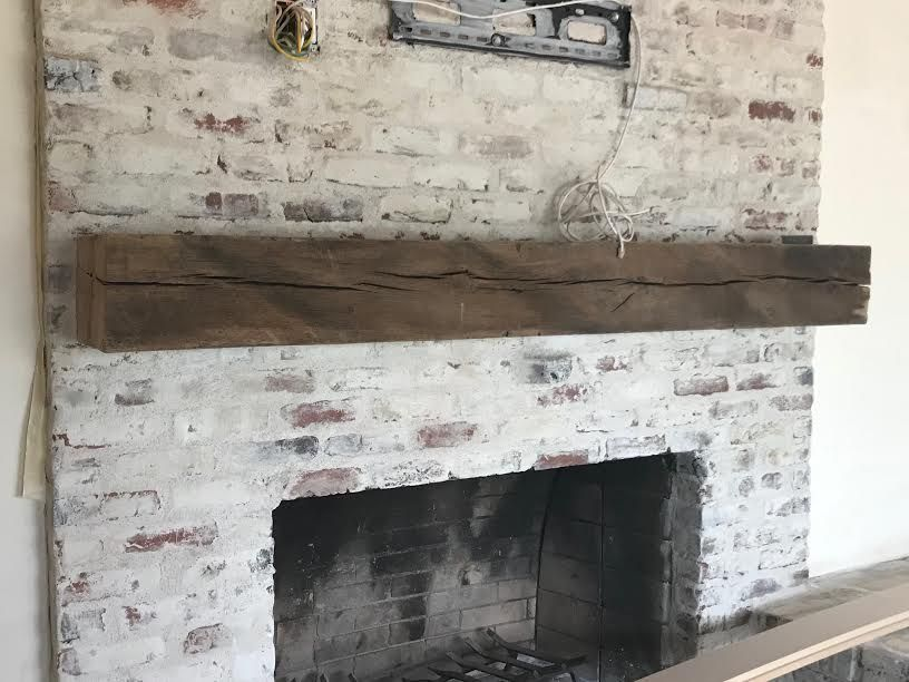 Hand Hewn Barnwood Mantel On White Wash Brick Fireplace Wall