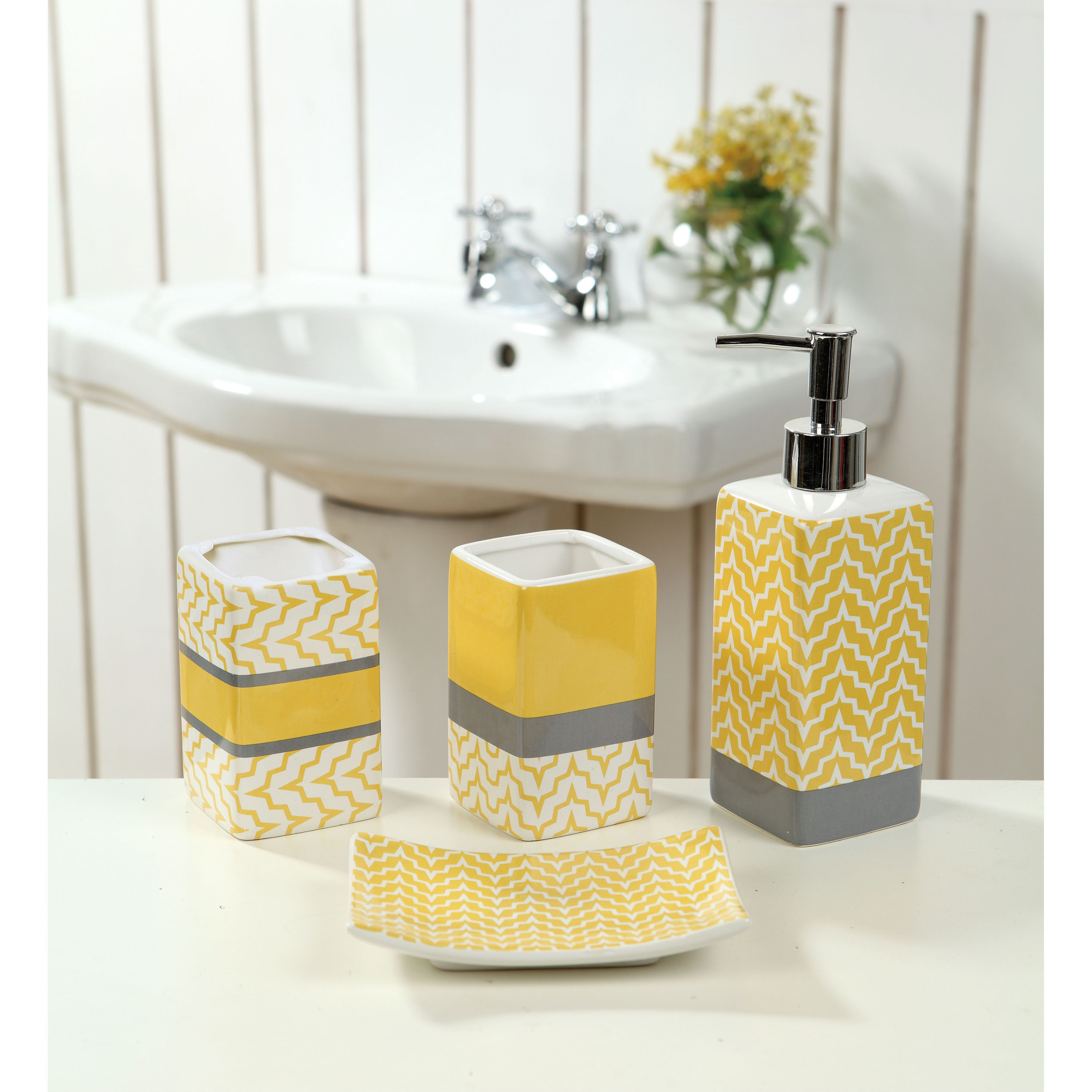 This ceramic yellow chevron bath set is sure to add a