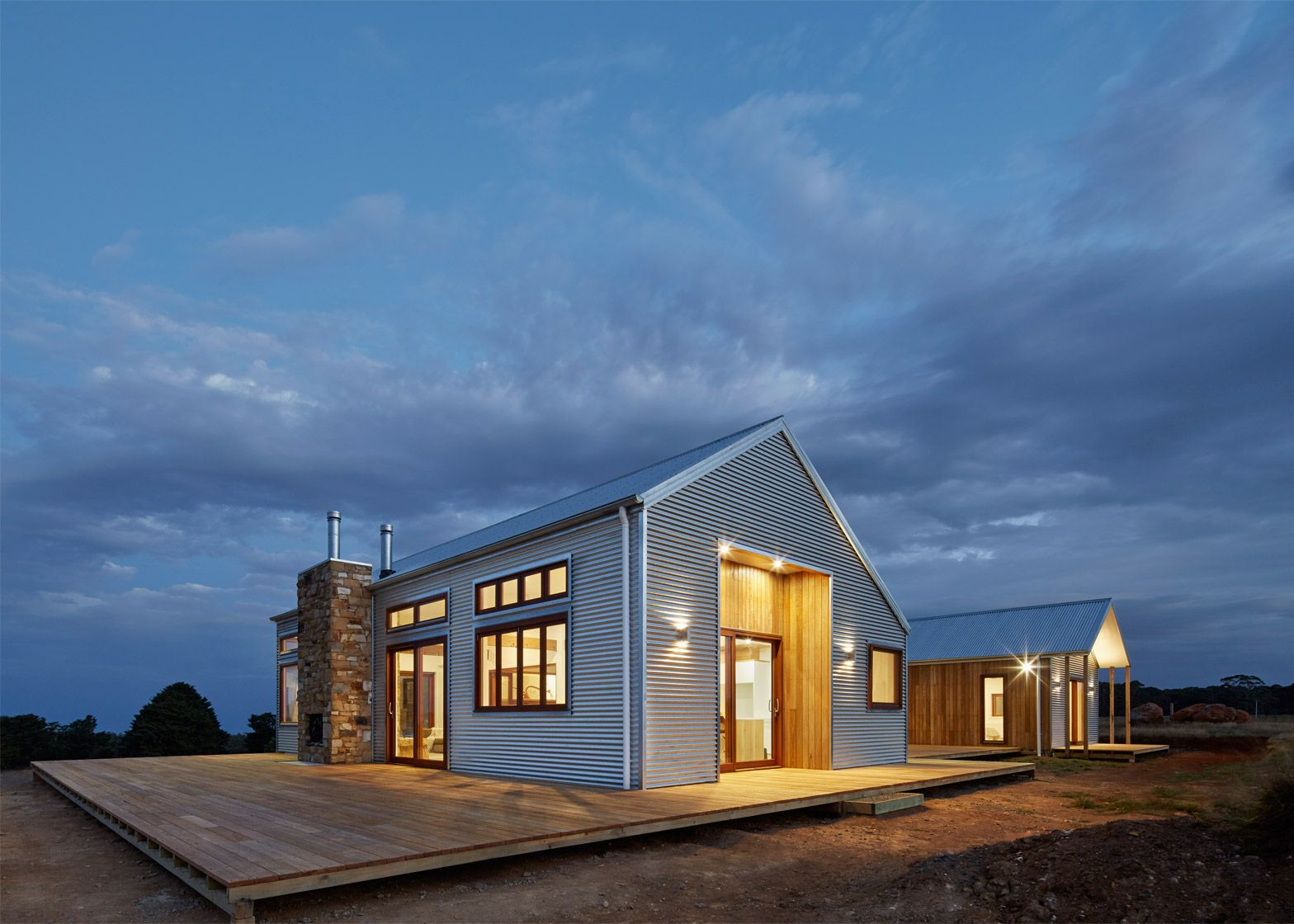 Corrugated Steel Provides Durable Facade For House By Glow Design Group Metal Building Homes Barn Style House Shed Homes