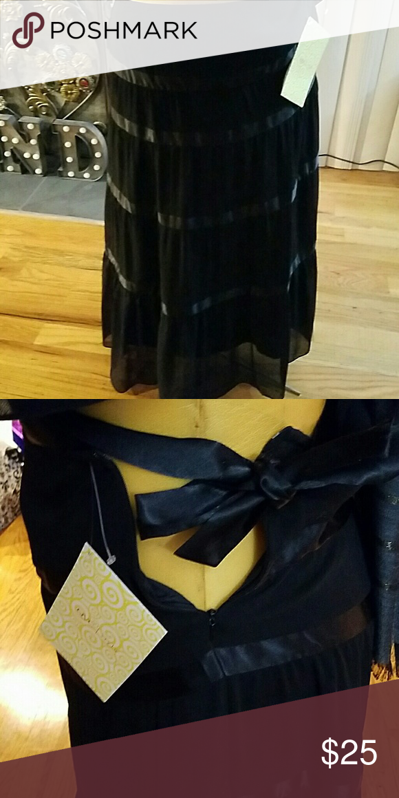 Skirt Beautiful and flowing peasant style skirt with the look and feel of chiffon.  Satin belt around waist with side zipper. Rows of satin around skirt. Fully lined Can be worn for a night on the town, wedding or any formal affair Polyester. Size M be appears to run larger Victor Costa Skirts Maxi