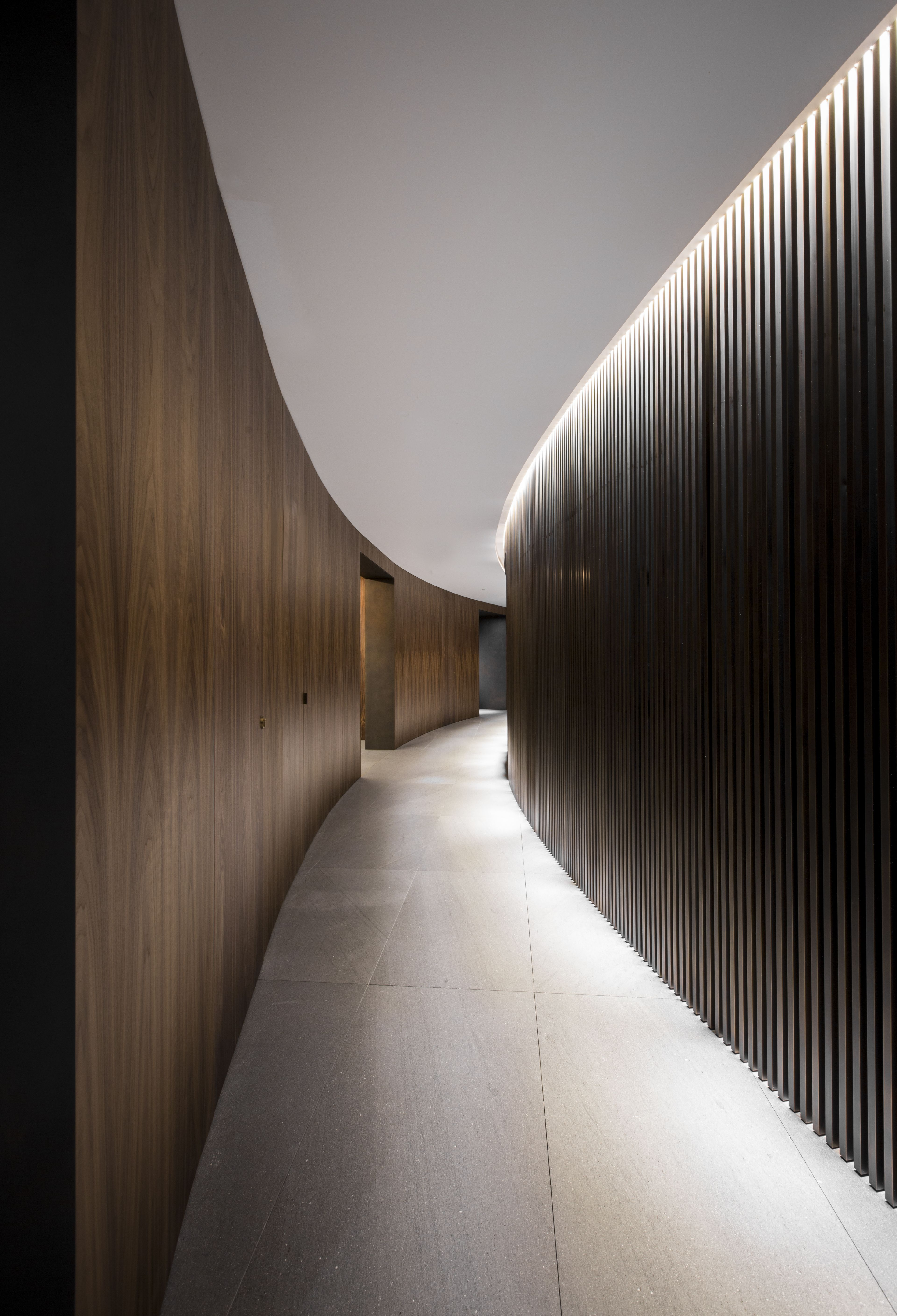 Hotel Room Wall: Curved Corridor With Wood-panelled Walls, White Ceiling