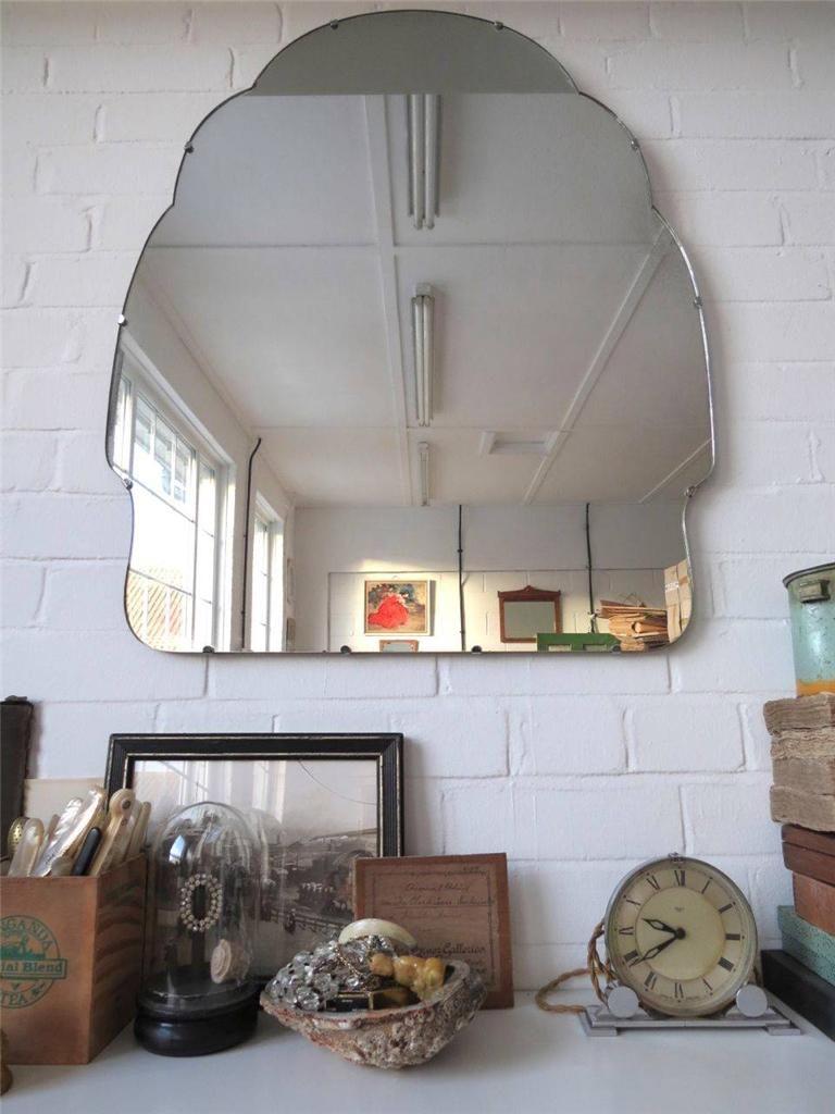 Unique art deco wall mirror