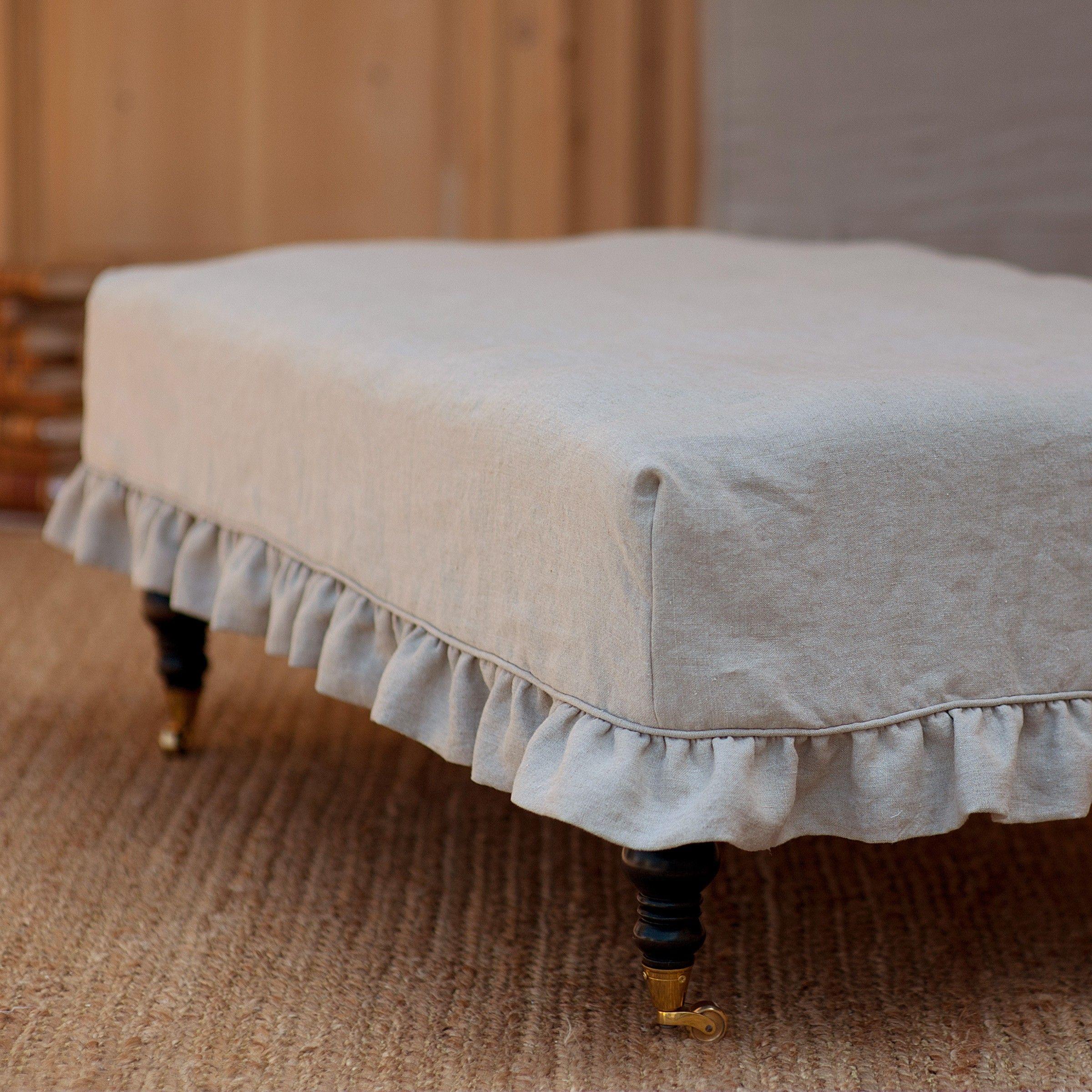 Custom made linen slipcovered ottoman charming cupboard