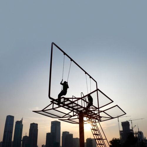 Architect didier faustino created this swing set out of a converted advertising billboard for the shenzhen-hong kong bi-city biennial of urbanism and architecture